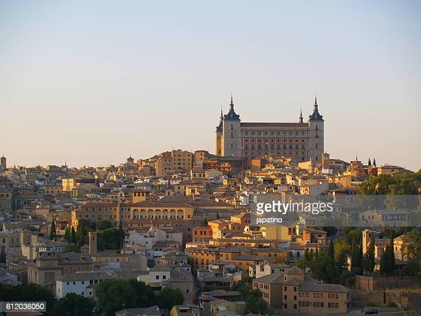 overview of the city of toledo and the tajo river that surrounds the city - traditional windmill stock photos and pictures