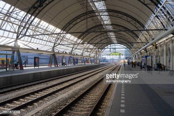 overview of the train station and railway in zwolle, a city in the netherlands - zwolle stock photos and pictures