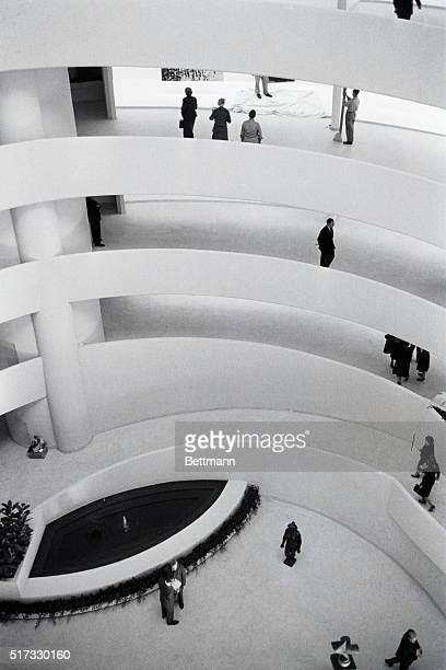 Overview of the white spiral ramp inside the Solomon R Guggenheim Museum designed by architect Frank Lloyd Wright New York New York