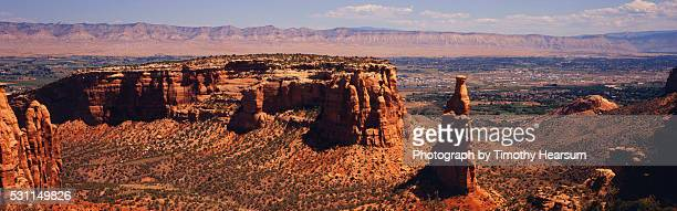 overview of town and mountains from ridge of red rock formations - timothy hearsum stock pictures, royalty-free photos & images