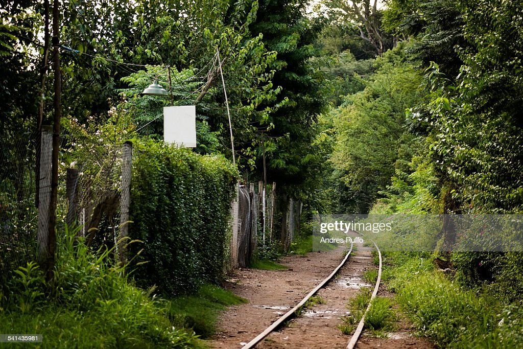 Overview of train tracks next to houses : Stock Photo