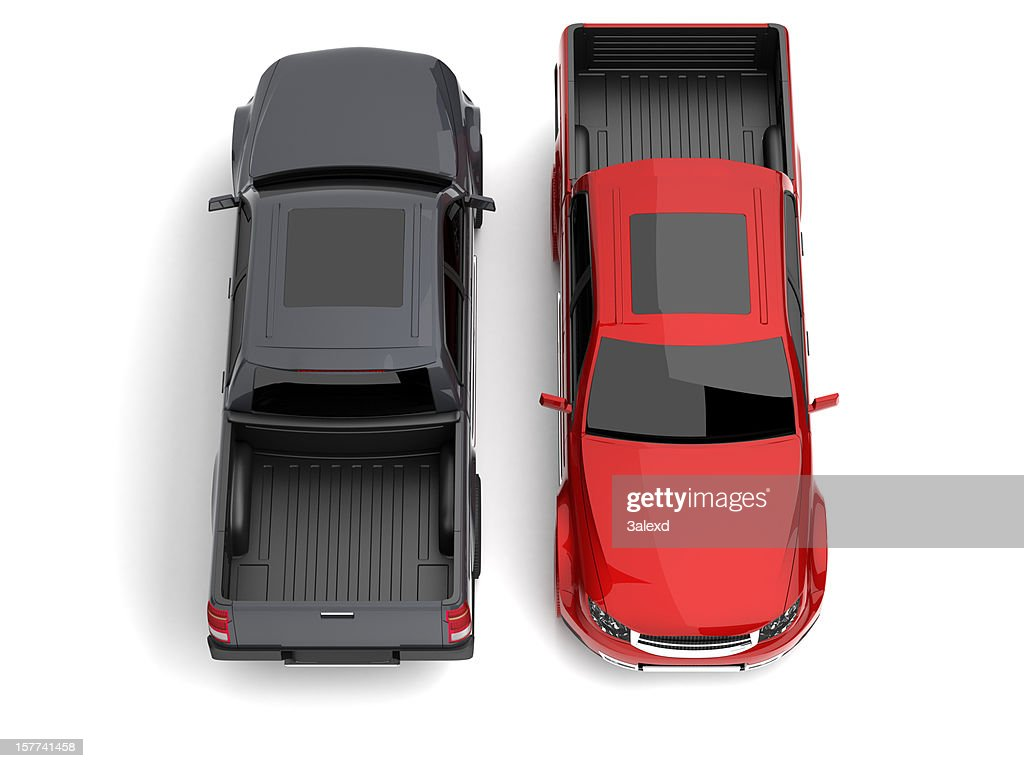 Overview of two pick-up trucks, one black and one red : Stock Photo