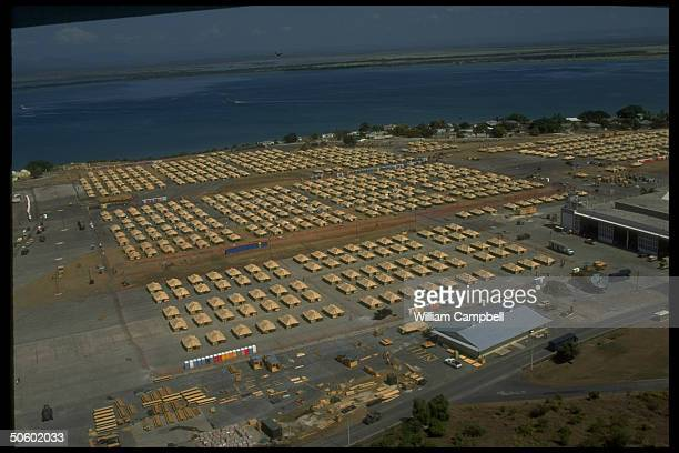 Overview of USrun refugee camp w rows of tents housing Haitians applying for safe haven status at US naval base in Guantanamo Bay Cuba