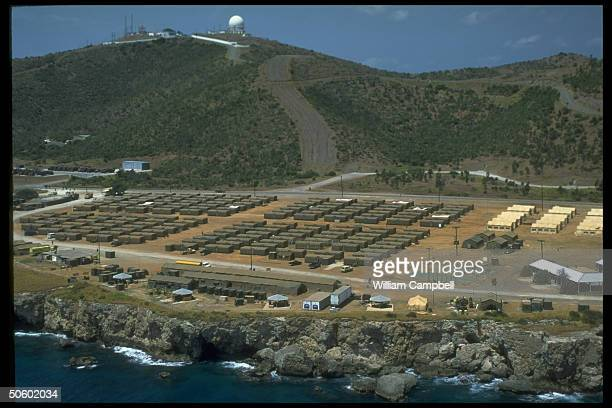 Overview of US-run refugee camp w. Rows of tents housing Haitians applying for safe haven status at US naval base in Guantanamo Bay, Cuba.