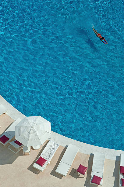 Overview Of Woman Swimming In Pool, Cancun, Mexico Wall Art