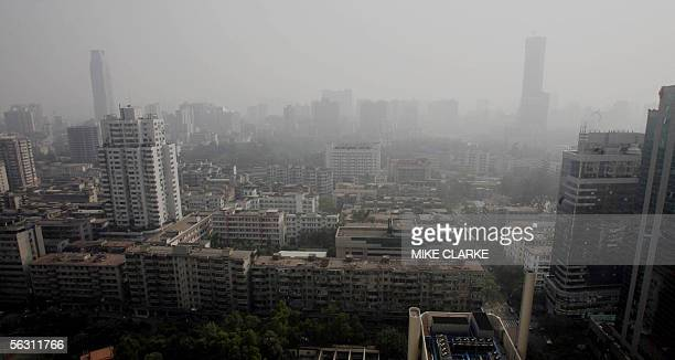 Overview on a smog ridden day of the city of Guangzhou 01 December 2005 AFP PHOTO/MIKE CLARKE