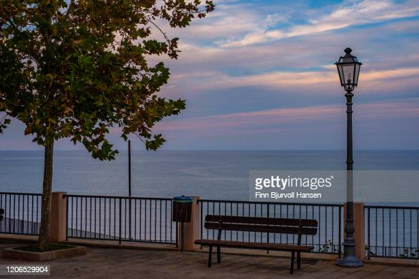 overview over the mediterranean ocean from a plaza in finale sicilly - finn bjurvoll stock pictures, royalty-free photos & images