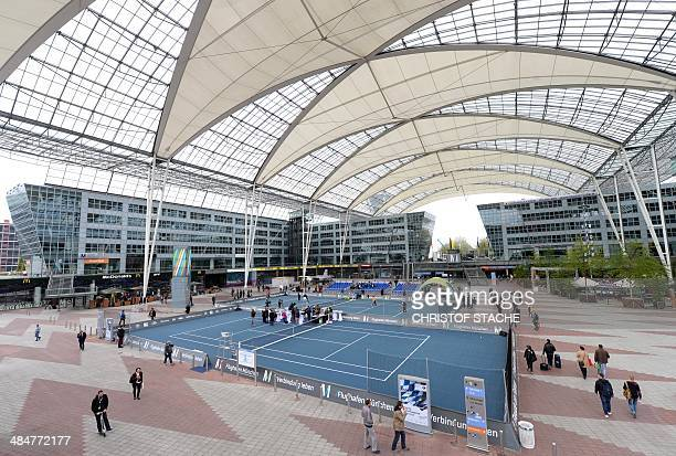 Overview picture of tennis courts which are built between two terminals of the FranzJosefStraussairport in Munich southern Germany during a show...