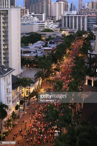 Overview shot of participants running in Waikiki area during The Hapalua 2017 Hawaii's Half Marathon on April 9 2017 in Honolulu Hawaii