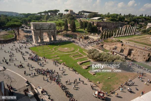 Overview taken from the top of the Colosseum shows the Arch of Constantine and people queuing to enter the Colosseum on October 3 2017 in Rome...