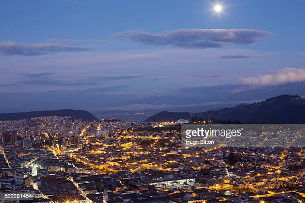 overviewing city at dusk, quito, ecuador - hugh sitton stock pictures, royalty-free photos & images