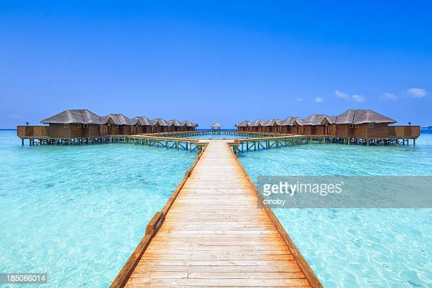 overwater bungalows boardwalk - tourist resort stock pictures, royalty-free photos & images