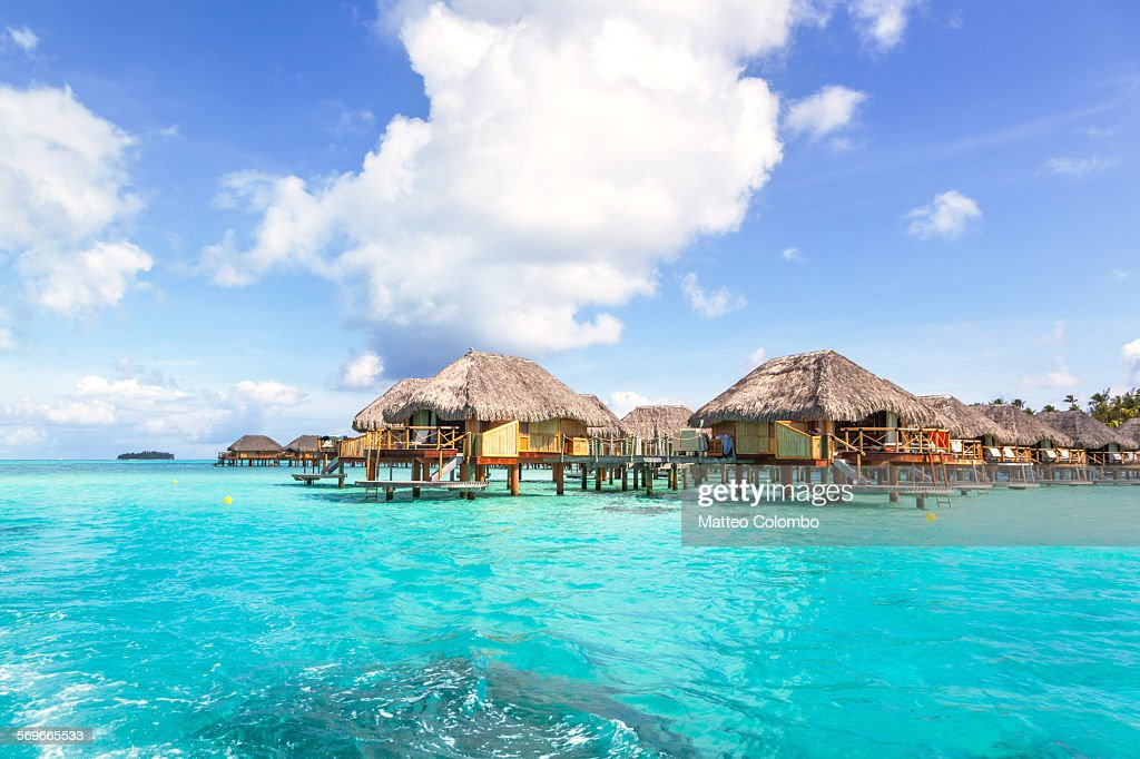 Overwater Bungalows In The Lagoon Of Bora Bora High Res