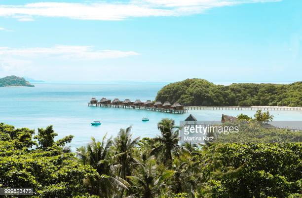 overwater bungalows in the sea, the south seas, malolo island, mamanuca islands, fiji - western division fiji stock photos and pictures