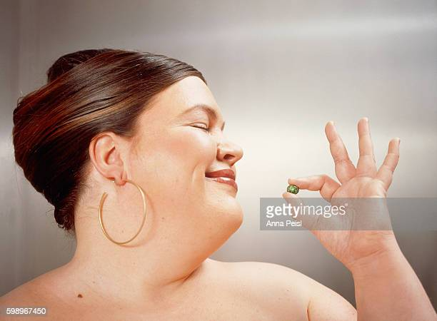 overweighed woman with candy in her hand - fat woman funny stock photos and pictures