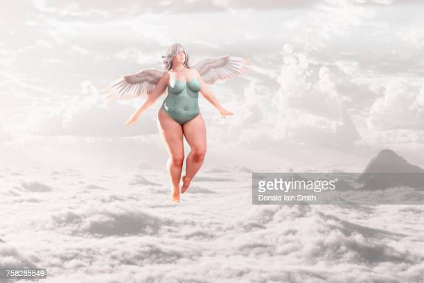 overweight angel flying in clouds - hovering stock pictures, royalty-free photos & images