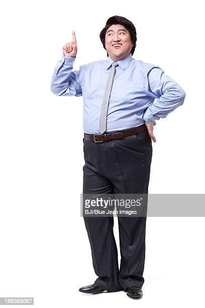 Overweight businessman raising index finger up