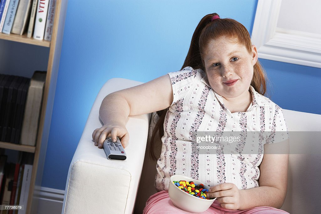 Overweight Child Eating Junk Food : Stock Photo
