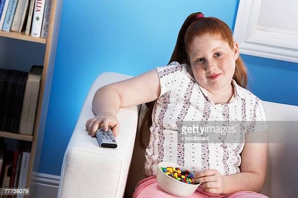 overweight child eating junk food - redhead girl stock photos and pictures