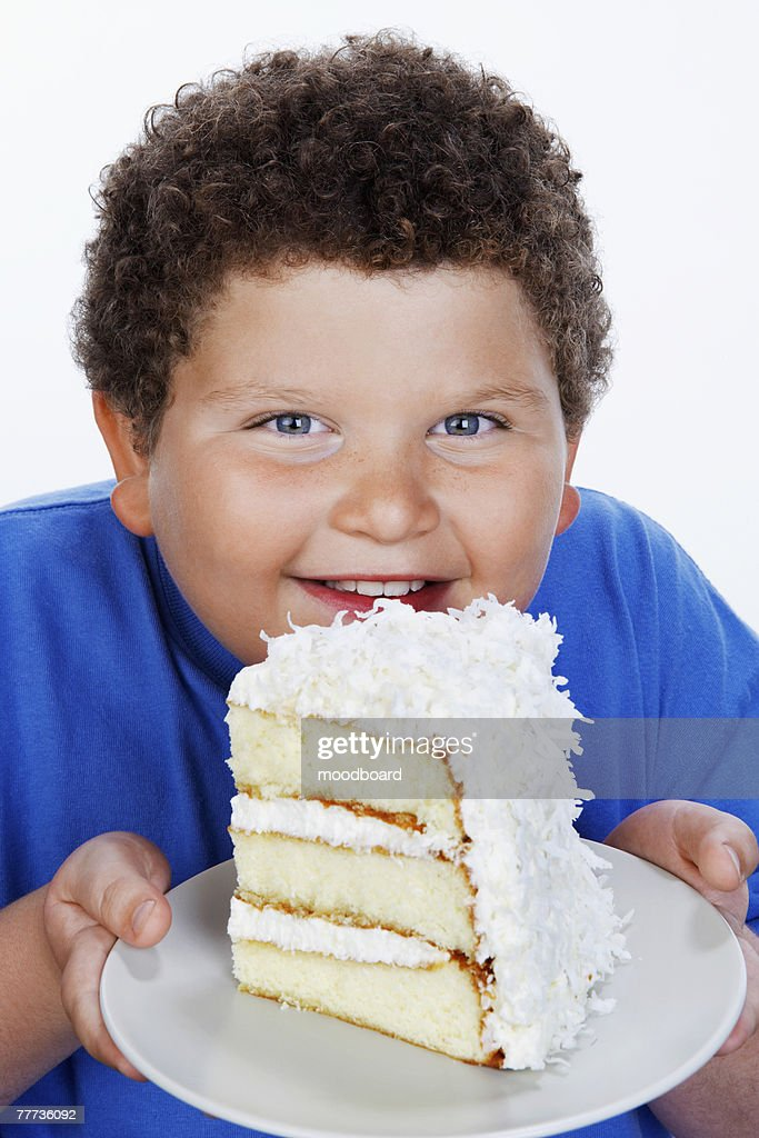 Fat Kid Eating Cake Stock Photos and Pictures Getty Images