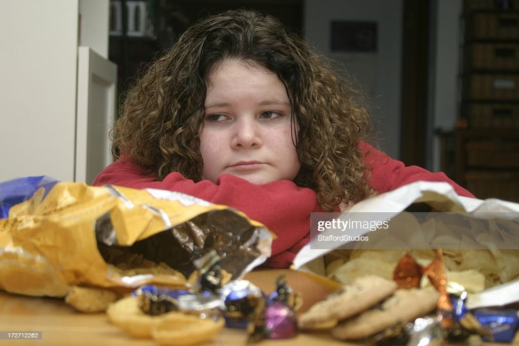 Overweight Child with Junk Food : Stock Photo