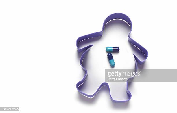 overweight cookie cutter with diet pills - body conscious stock pictures, royalty-free photos & images