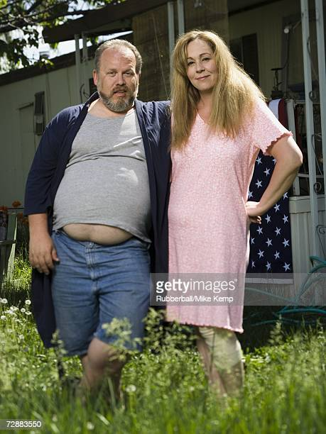 overweight couple in a trailer park - redneck stock photos and pictures