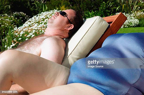 overweight couple sunbathing - female hairy chest stock pictures, royalty-free photos & images