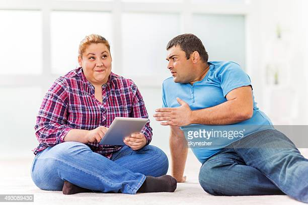 Overweight couple with relationship difficulties.