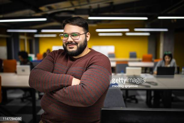 overweight entrepreneur in modern office - large build stock pictures, royalty-free photos & images