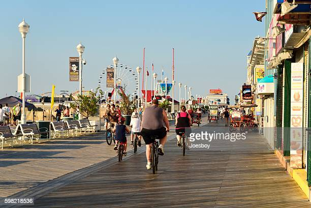 overweight family biking on ocean city boardwalk - ocean city maryland stock pictures, royalty-free photos & images