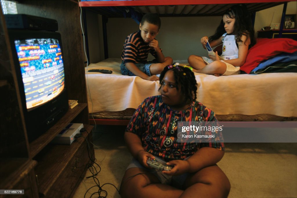 Overweight Girl Playing Video Games : Stock Photo