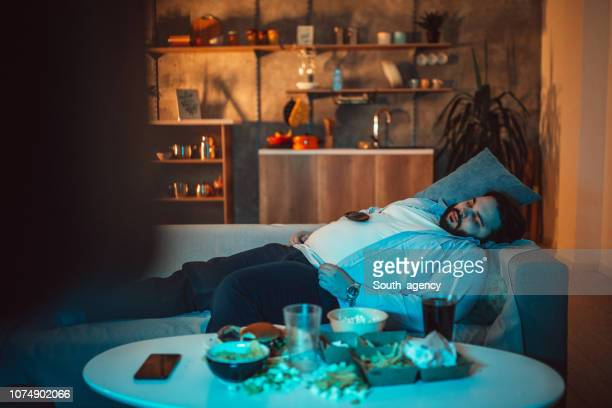 overweight guy napping - unhealthy living stock pictures, royalty-free photos & images