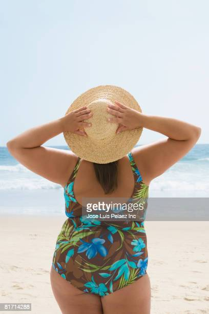 overweight hispanic woman at beach - chubby swimsuit stock photos and pictures