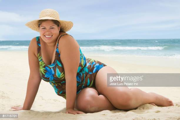 overweight hispanic woman at beach - fat woman at beach stock pictures, royalty-free photos & images