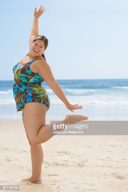 overweight hispanic woman posing at beach - fat woman at beach stock photos and pictures