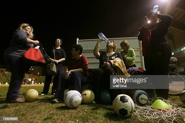 Overweight Israeli women take a break as they play soccer as part of a weightloss program based on the sport on February 12 2007 in Tel Aviv Israel...