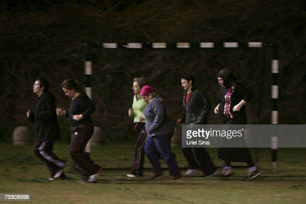 Overweight Israeli women warm up during their soccer practice as part of a weightloss program based on the sport on February 12 2007 in Tel Aviv...