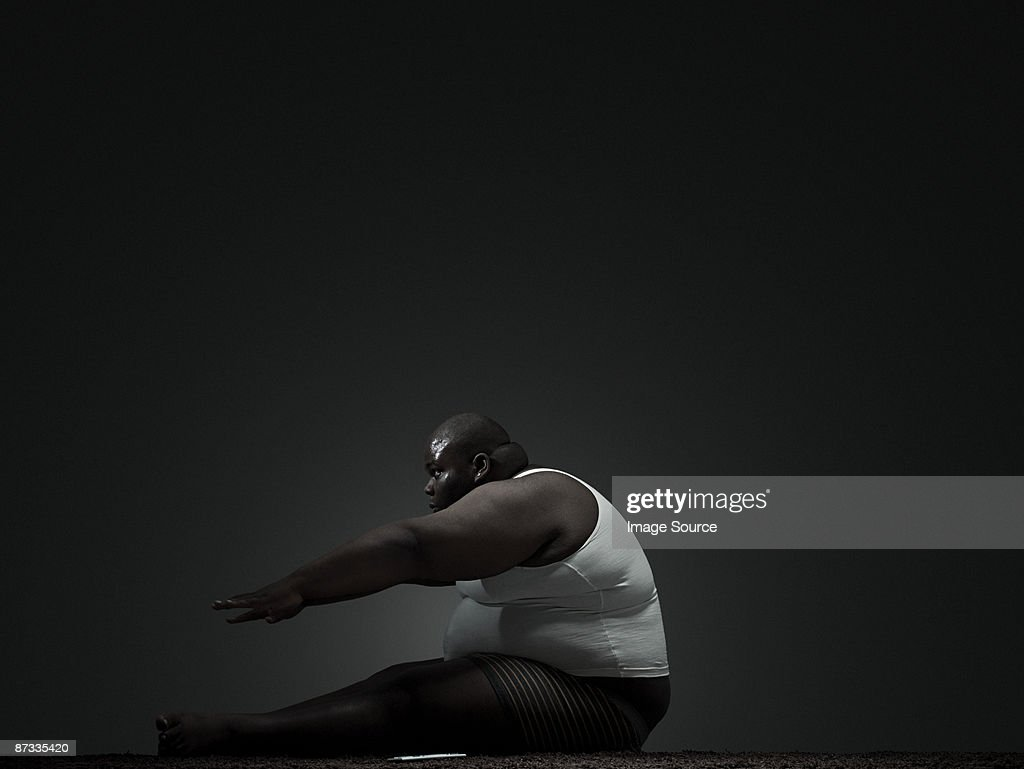 Overweight man doing sit up : Stock Photo