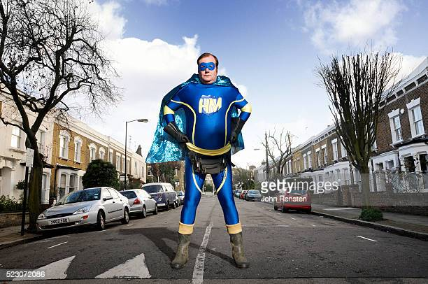 overweight man dressed as hero - waist pack stock pictures, royalty-free photos & images