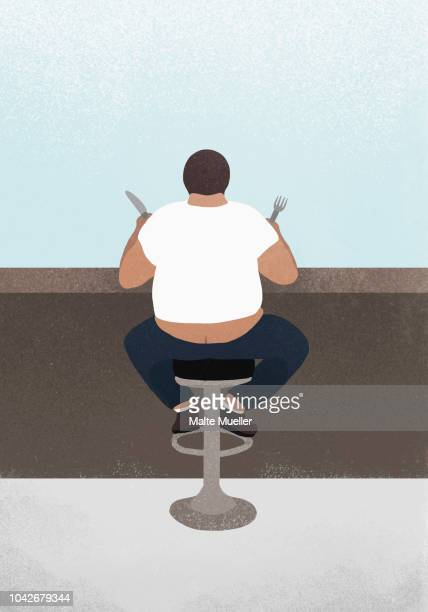 overweight man eating at diner counter - builders bum stock pictures, royalty-free photos & images