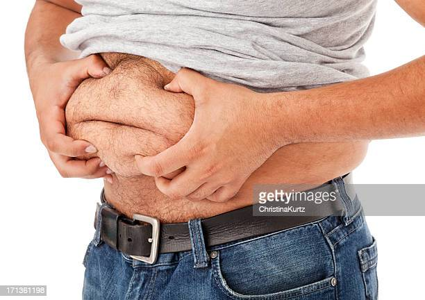 Overweight Man Grabbing His Gut