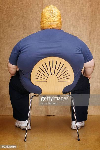 Overweight man in chair