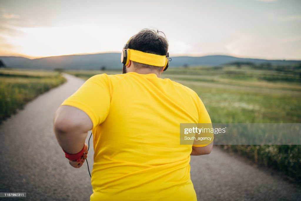 Overweight man jogging : Stock Photo