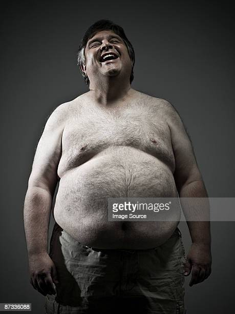 overweight man laughing - hairy chest stock photos and pictures