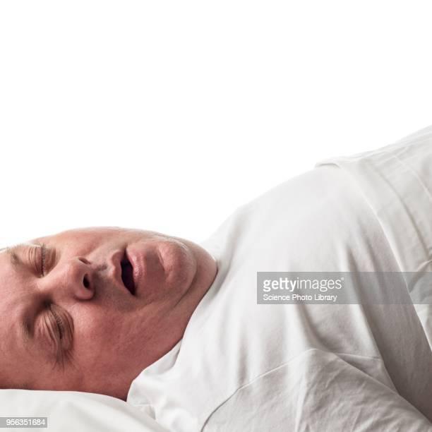 Overweight man lying down asleep