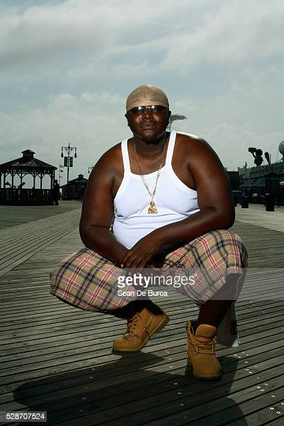 overweight man on boardwalk - fat black man stock photos and pictures
