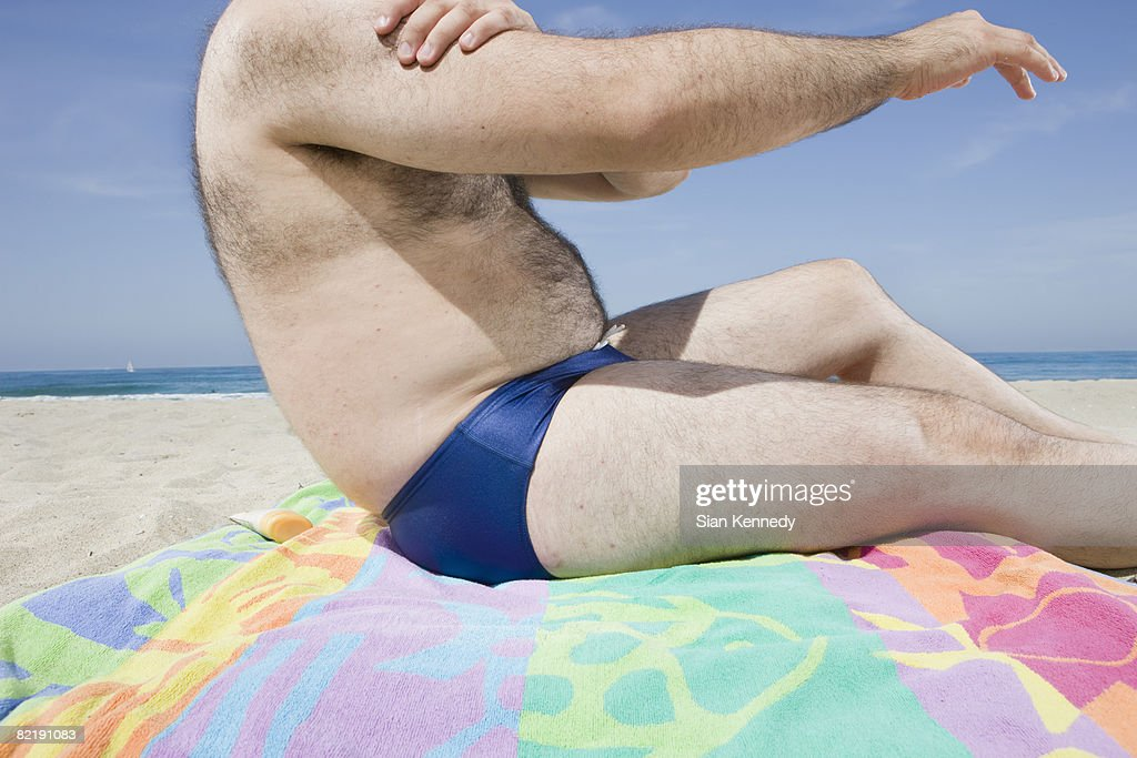 Overweight man on the beach, close-up of torso : Stock Photo