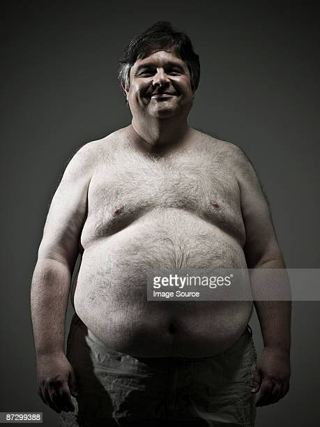 overweight man - hairy chest stock photos and pictures