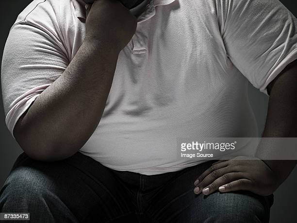 overweight man - fat black man stock photos and pictures